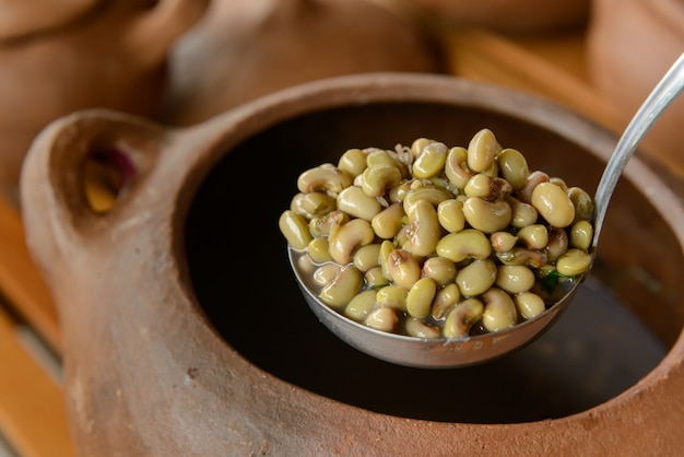 Green beans with blurred clay pots in the background traditional cuisine from northeastern brazil