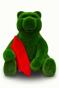 Green bear with red candy on a white background