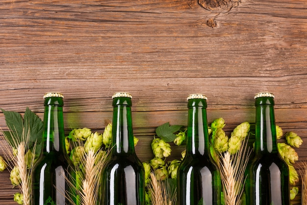 Green beer bottles on wooden background