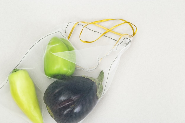 Green bell peppers and eggplants in eco natural bags