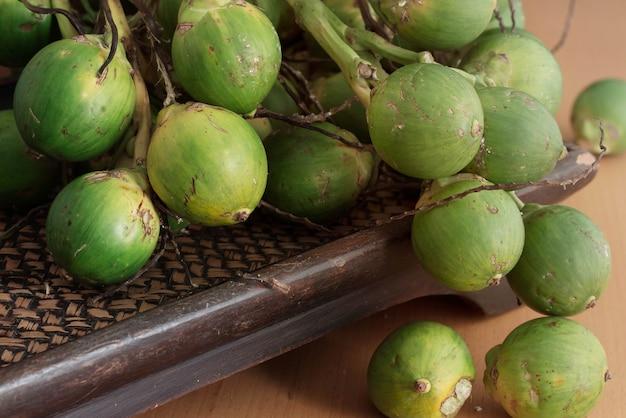 Green betel nut on tray.