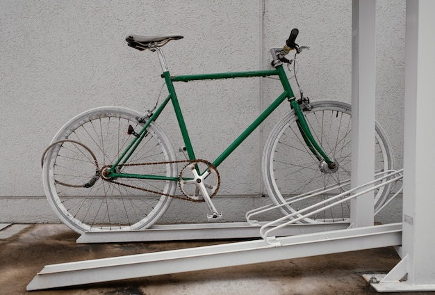 Green bicycle with white details