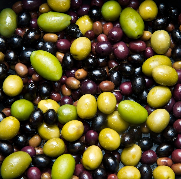 Green and black olives background