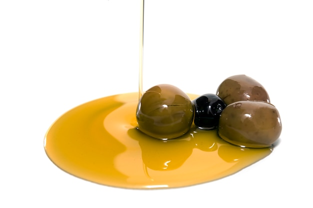 Green and black olives with olive oil