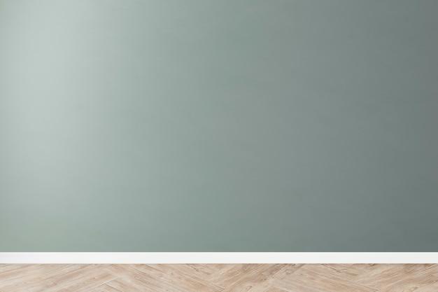 나무 바닥과 녹색 빈 콘크리트 벽 모형