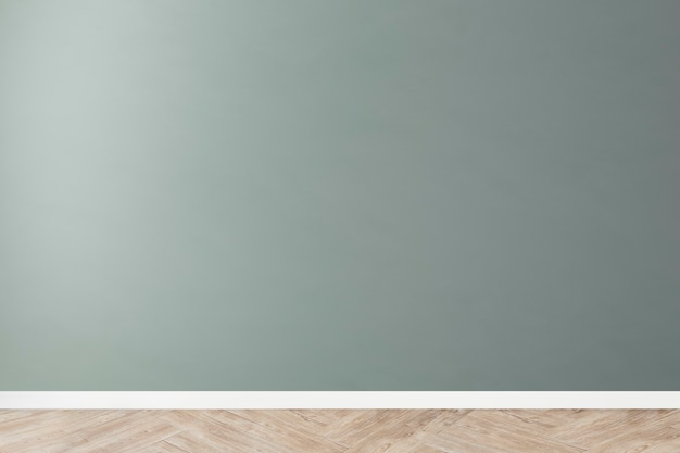 Green blank concrete wall mockup with a wooden floor