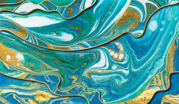 緑、青、金の波紋の背景。レイヤーを持つ大理石のテクスチャ。金粒子。
