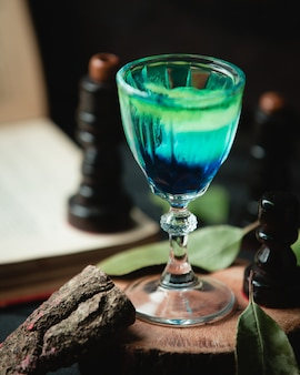 Green blue cocktail on the table