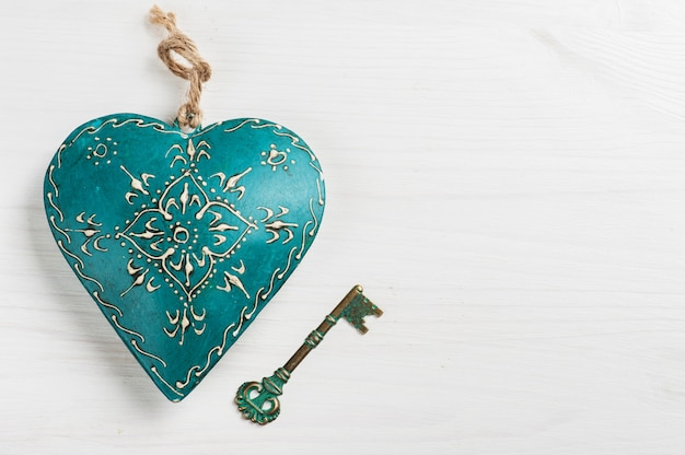 Green blue heart and key