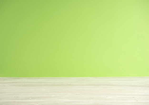 Green blur background with wooden floor