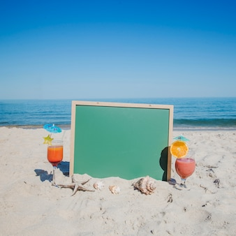 Green board with cocktails near