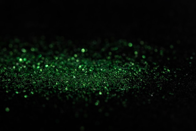 Green bokeh from carborundum on black background