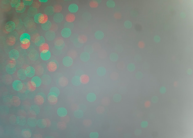 Green bokeh light on gray backdrop