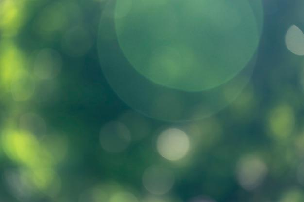 Зеленый боке природа блестящий абстрактный фон