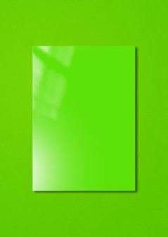 Green booklet cover isolated on colorful background, mockup template