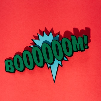 Green boom text over the blue speech bubble against red background