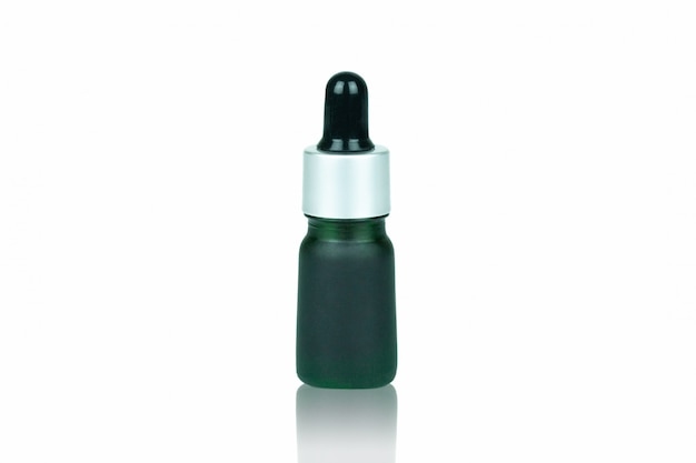 Green bottle dropper for contain liquid cannabis isolated on white