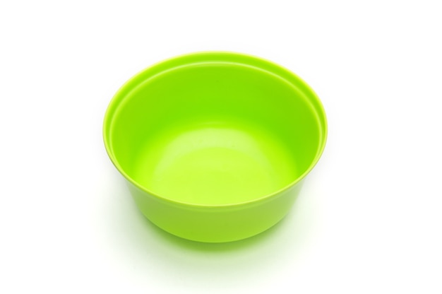 Green bowl for fruits and vegetables on an isolated white background