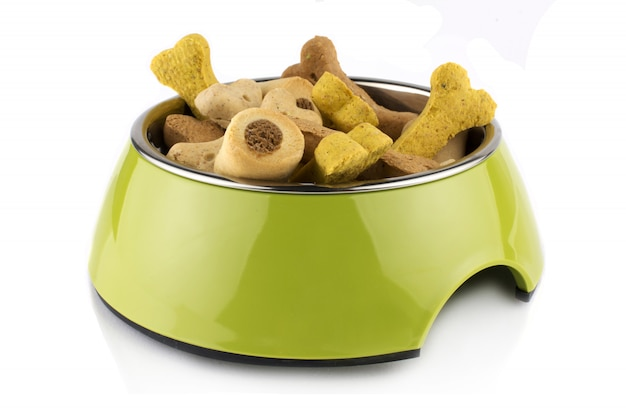 Green bowl methacrylate food treats container for dog or cat with food. isolated on white background.