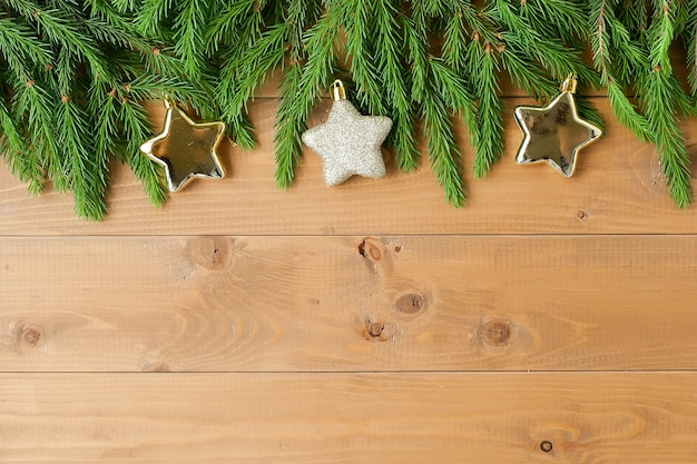 Green branches of a fir tree with christmas ornaments