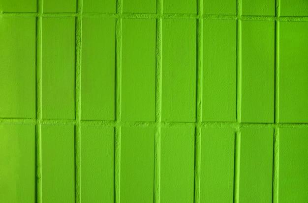 Зеленая кирпичная стена как фон