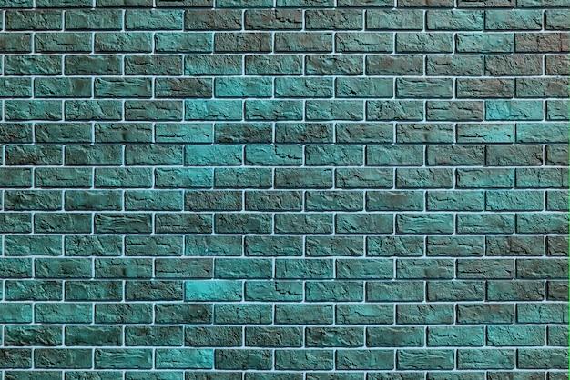Green brick wall. modern construction industry. building's facade.