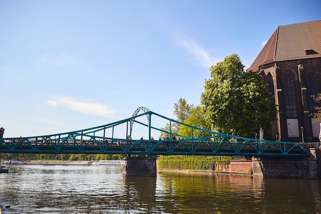 Green bridge adorned with many love locks and hearts, in wroclaw