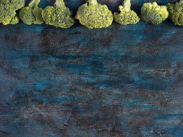 Green broccoli scattered on table