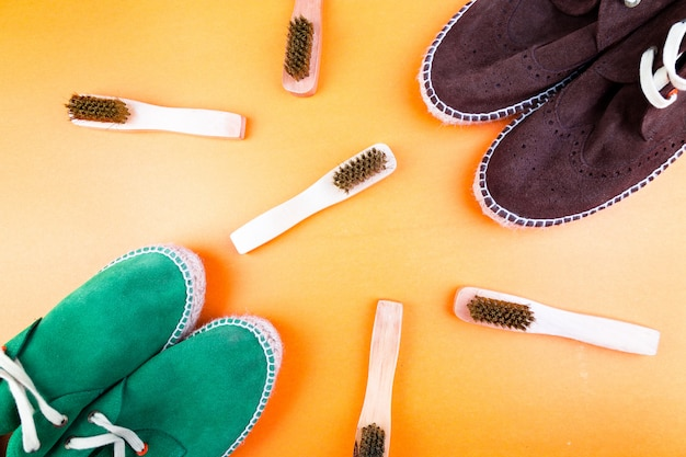 Green and brown suede espadrille shoes with brushes,
