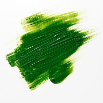 白い背景の上の緑のブラシストローク