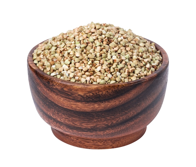 Green buckwheat in wooden bowl isolated on white