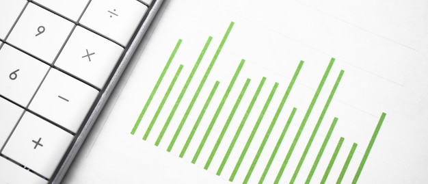 Green business chart and a calculator