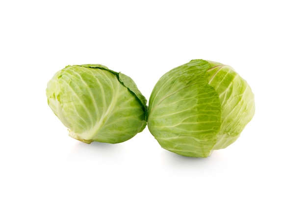 Green cabbages isolated on white surface
