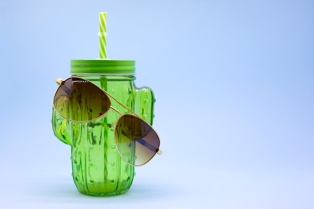 Green cactus cup for cocktails with sunglasses