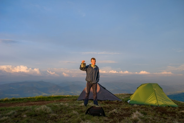Green camping tent and man