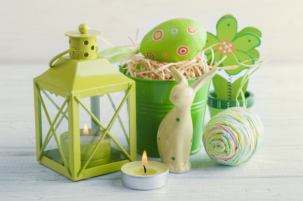 Green candle, toy rabbit, candle and eggs