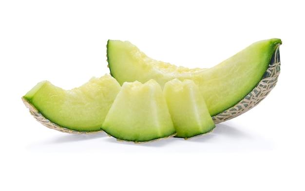 Green cantaloupe melon slices isolated