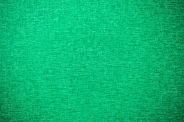 緑のキャンバスのテクスチャと背景の表面