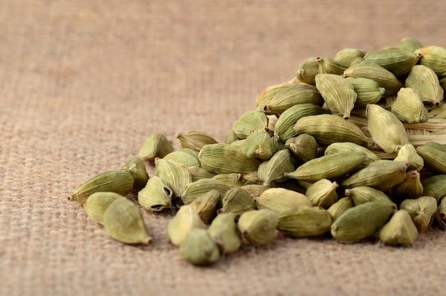 Green cardamom pods on sack cloth