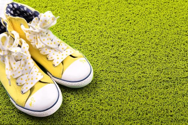 Green carpet and converse close-up