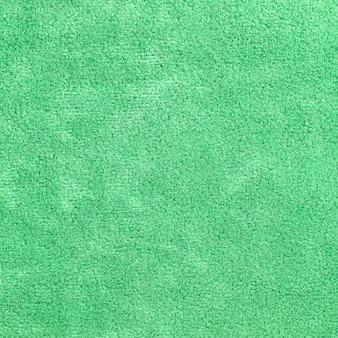 背景のための緑のカーペットのテクスチャ