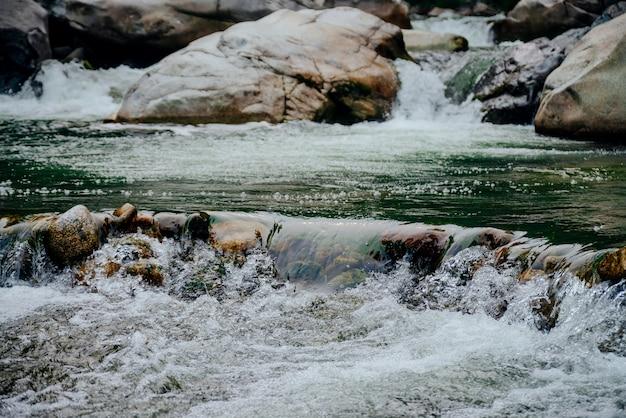 Green cascades of mountain creek.