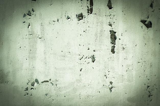 緑、青磁、質感。古いさびた壁の背景。粗さとひび。フレーム、ビネット