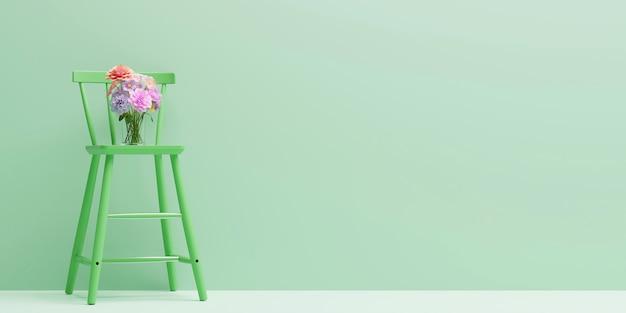 明るい緑の色のリビングルームでカラフルな花と緑の椅子。