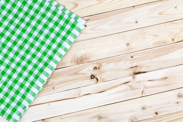Green checkered tablecloth on wooden table