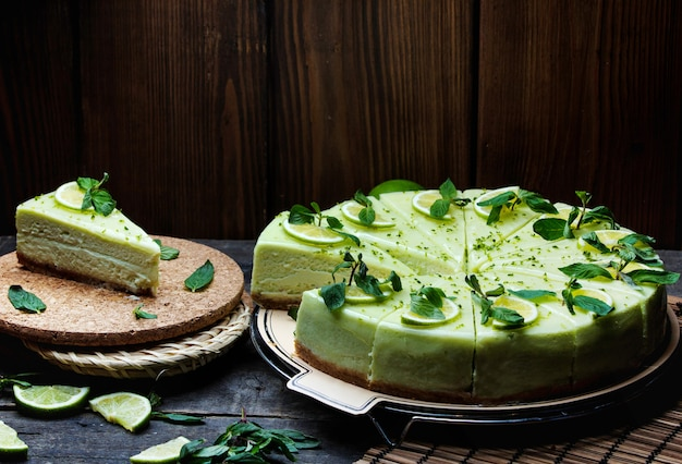 Green cheesecake topped with lemon and mint