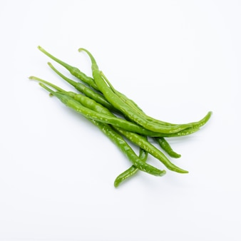 Green chillies on white background