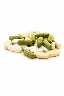 Green chlorophyll capsules  in white background