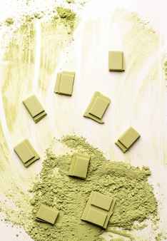 Green chocolate with matcha tea on a white background. view from above