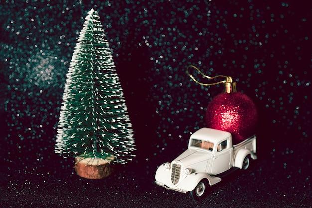 Green christmas tree on shiny background